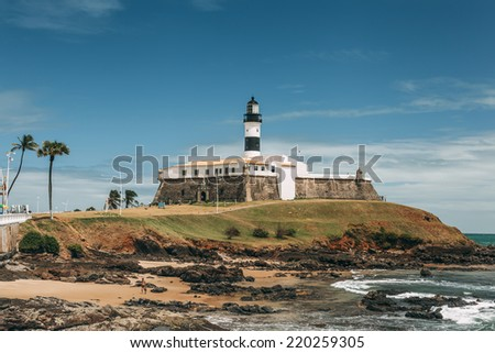 Barra Lighthouse (Farol da Barra) in Salvador, Brazil. It was built in 1698 and was the first lighthouse in the Americas. Its lamp was fueled by whale oil. The lighthouse was electrified in 1937.  - stock photo