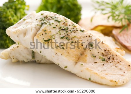 Barramundi Filet with Chips - stock photo