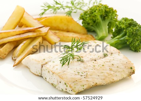 Barramundi Fillet with Chips - stock photo
