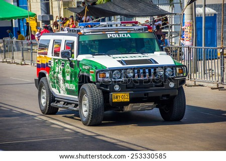 BARRANQUILLA, COLOMBIA - FEBRUARY 15, 2015: Police cars patrolling streets just before Colombia's most important folklore celebration, the Carnival of Barranquilla, Colombia - stock photo