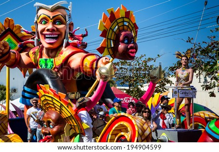 Barranquilla, Colombia - March 1, 2014 - Colorful floats full of singers, dancers, and models make their way down the street during the Battalla de Flores. The pinnacle of the Carnaval de Barranquilla - stock photo