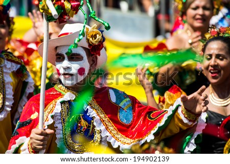 Barranquilla, Colombia - March 1, 2014 - Performers in elaborate costume sing, dance, and stroll their way down the streets of Barranquilla during the Battalla de Flores during Carnival - stock photo