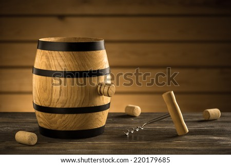 Barrel and corkscrew on the table