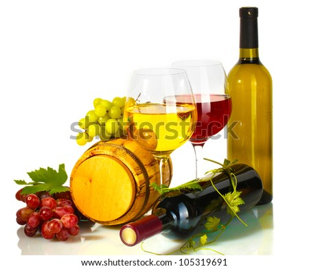 barrel, bottles and glasses of wine and ripe grapes isolated on white