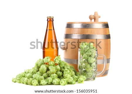 Barrel mug with hop and bottle of beer. Isolated on a white background. - stock photo