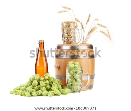 Barrel mug with hops and bottle of beer. Isolated on a white background. - stock photo