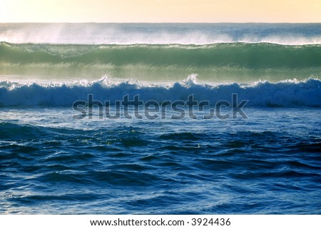 barrel ocean wave about to break in the early morning surf - stock photo