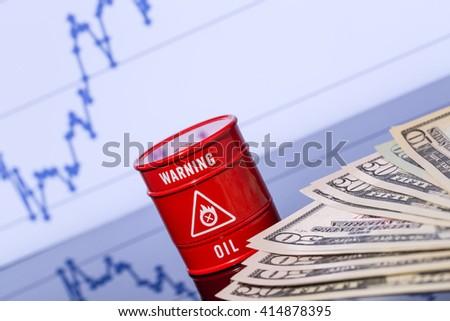 barrel of oil, dollars on blue chart - stock photo