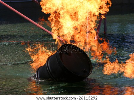 Barrel of oil on fire - stock photo