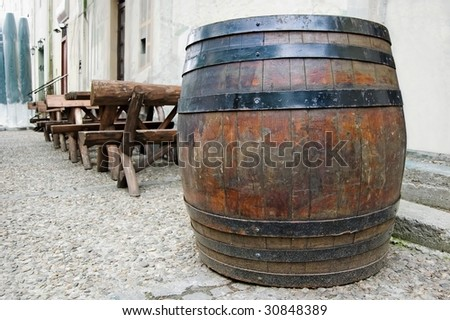 Barrel on the street, next to the local pub. - stock photo
