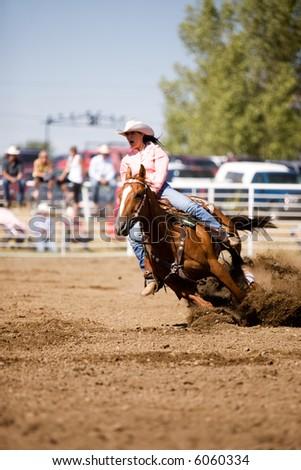 Barrel racing at a small town rodeo in Saskatchean - stock photo