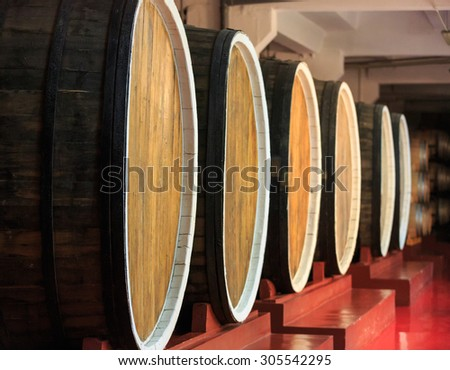 Barrel store in dark curing cellar - stock photo