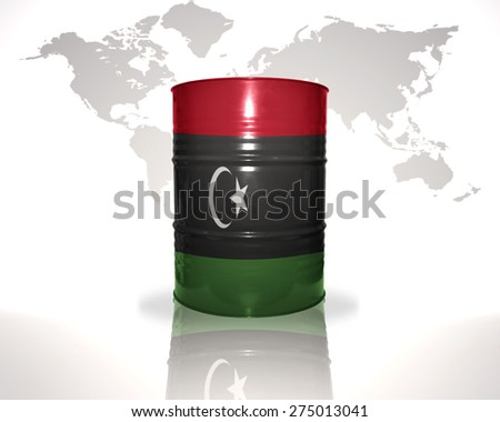 barrel with libyan flag on the world map background - stock photo