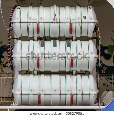 Barrels containing emergency rations for a cruise ship lifeboat - stock photo