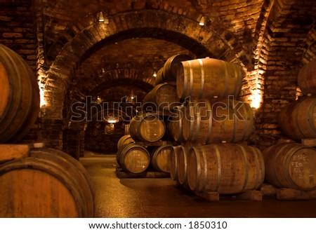 Barrels in a wine-cellar. - stock photo