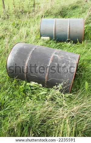 barrels in grass - stock photo