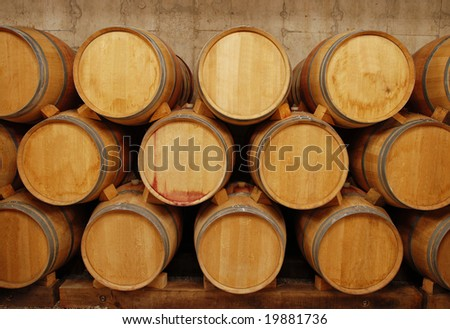 barrels of wine in storage - stock photo