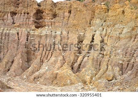barren hills due to dredging sand mining - stock photo