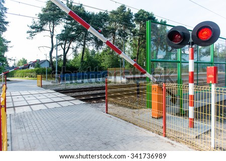barrier at the railway crossing. railway station - stock photo