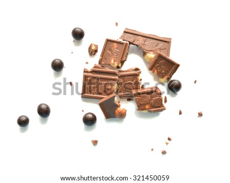Bars and balls of chocolate isolated