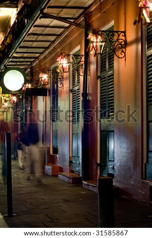 Bars at night in French Quarter, New Orleans - stock photo