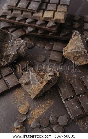 Bars, chopped and chips of dark chocolate  - stock photo