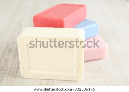 Bars of natural soap on light background - stock photo