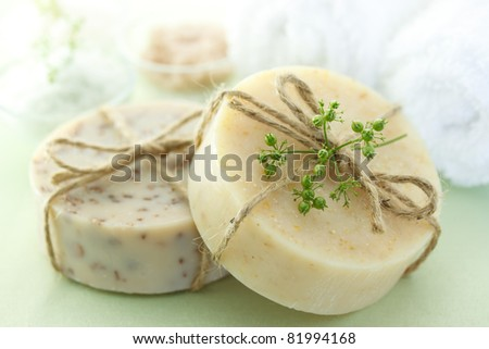 Bars of soap with bath salt and towels - stock photo