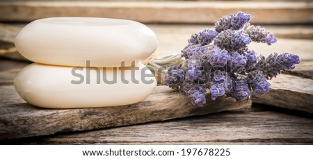 Bars of soap with lavender on a rustic wooden background