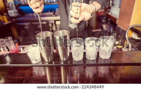 bartender at work. concept about american bartending and free pouring - stock photo