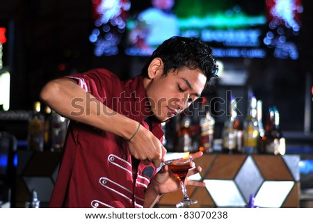 bartender in action - stock photo