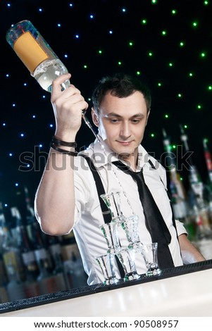 Bartender  is pouring a drink - stock photo