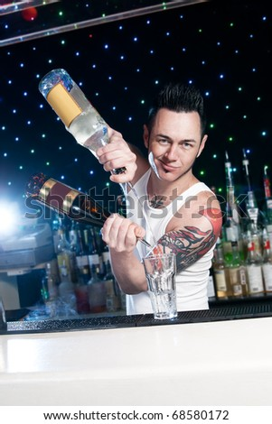 bartender is smiling and looking at the camera - stock photo