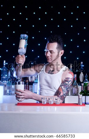 bartender is smiling and mixing coctail - stock photo