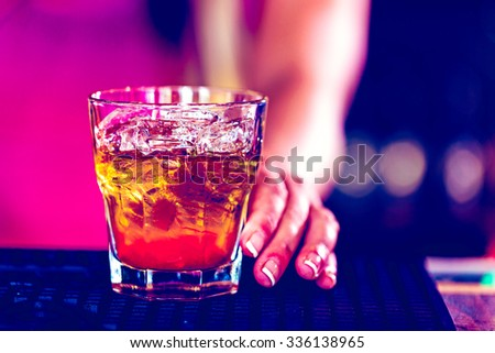 Bartender making new old fashioned cocktail in Italian restaurant. - stock photo
