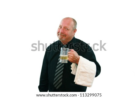 Bartender or waiter with a pleasant expression holding a half full mug of beer isolated on white. - stock photo