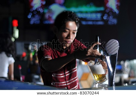 bartender pouring beer - stock photo
