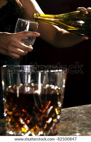 bartender pouring champagne - stock photo