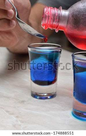 Bartender Prepares Tumblers and Shot Glasses for some Flair - stock photo