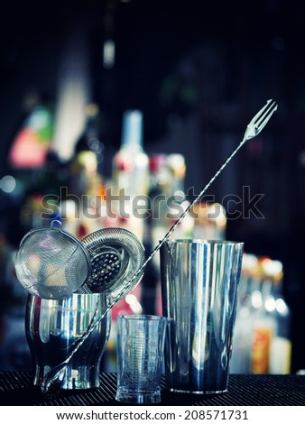 Bartender tools at the club over dark background - selective focus - stock photo