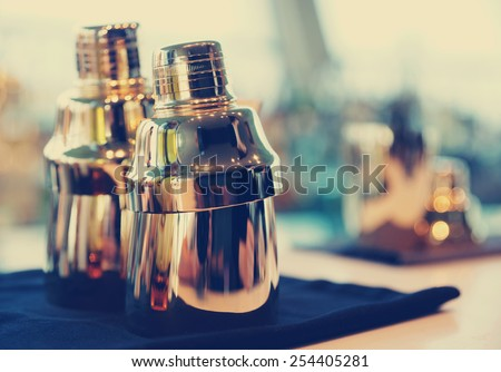 Bartender tools on bar counter, toned image - stock photo