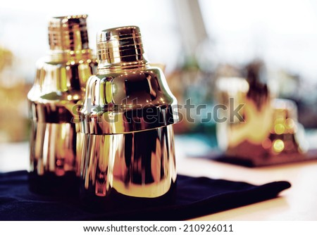Bartender tools on bar counter, warm light, toned image - stock photo