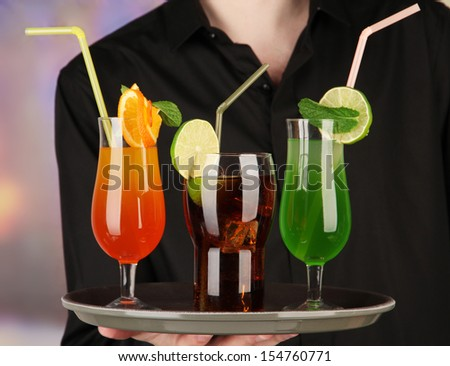 Bartender with different cocktails, close-up - stock photo