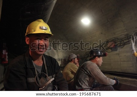 BARTIN-APRIL 5 : Unidentified Chinese mine workers began working in Turkey on April 5, 2014 in Bartin,Turke - stock photo