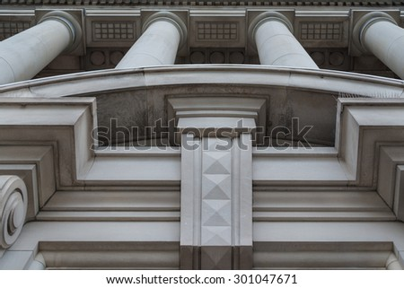 Bas-relief and columns on facade of Canada Life Building. The Canada Life Building is a historic office building in Toronto, Ontario, Canada. - stock photo