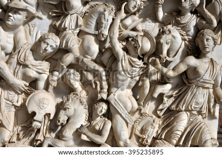 Bas-relief and sculpture of ancient Roman soldiers - stock photo