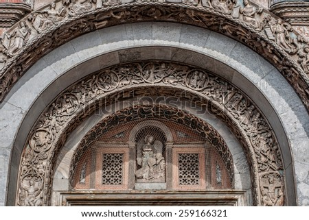 Bas-relief arch over the gate to the Saint Marks Basilica (Patriarchal Cathedral Basilica of Saint Mark) in Venice, Italy - stock photo