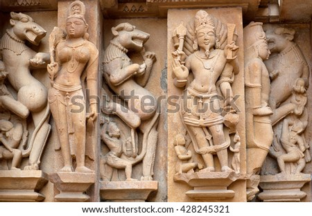 Bas-relief close up at famous ancient temple in Khajuraho, India. Most Khajuraho temples were built between 950 and 1050 by the Chandela dynasty.