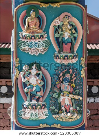 Bas-relief image of Buddhist gods on the columns of the main gate of the Tengboche monastery - Nepal - stock photo