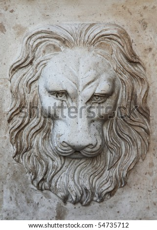Bas-relief of a head of a lion on a wall
